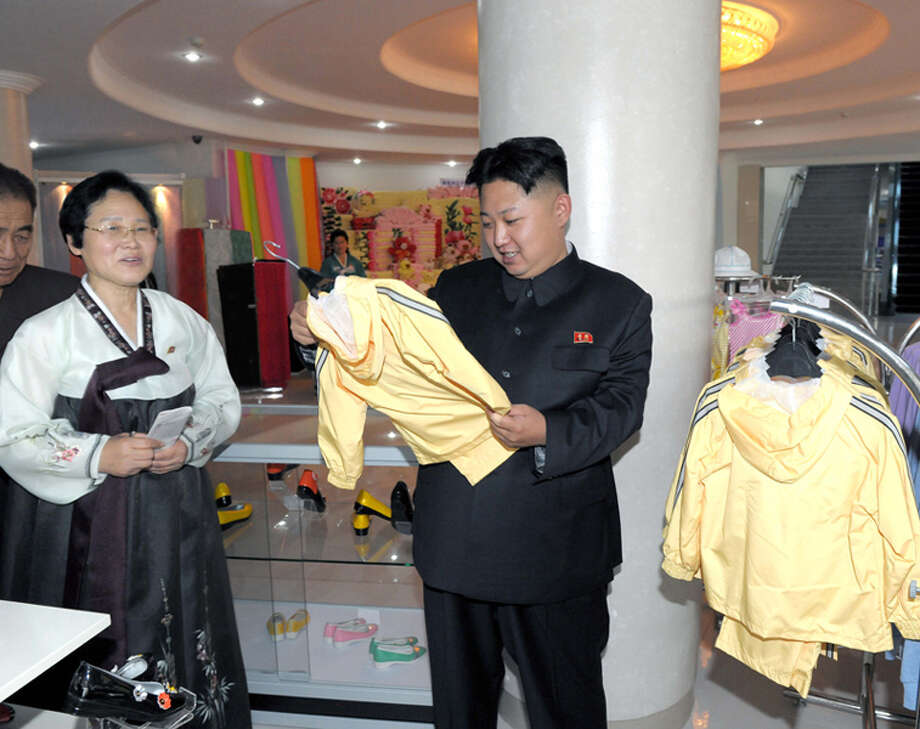 Kim Jong Un looking at children's clothing. Photo: Uriminzokkiri's Flickr Stream