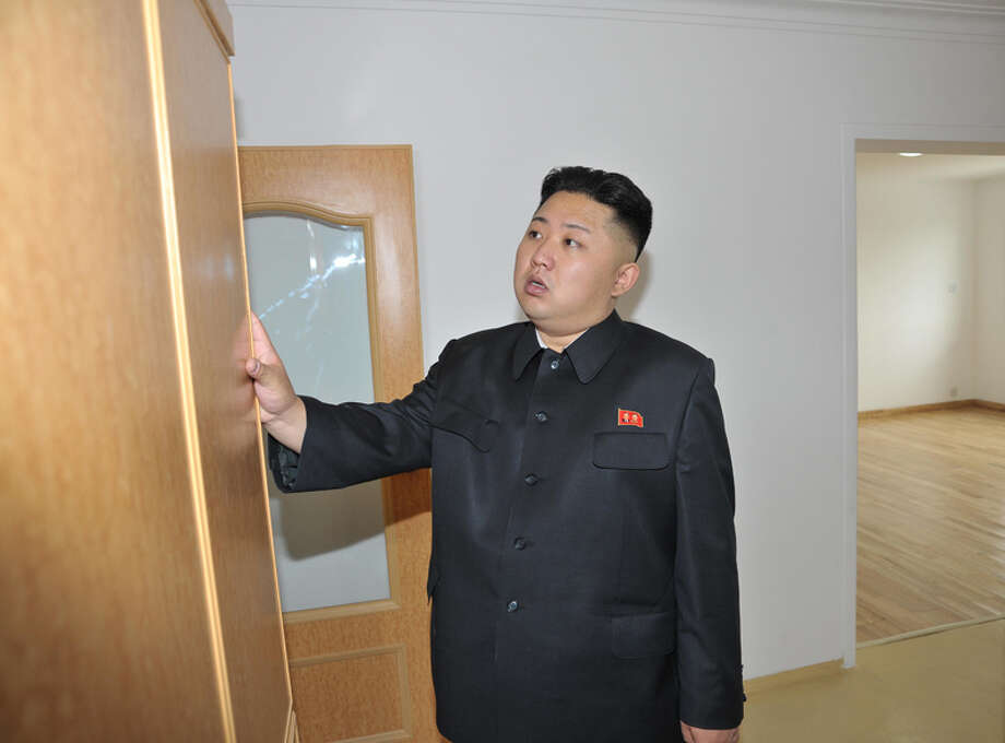 Kim Jong Un looking at a closet. Photo: Uriminzokkiri's Flickr Stream