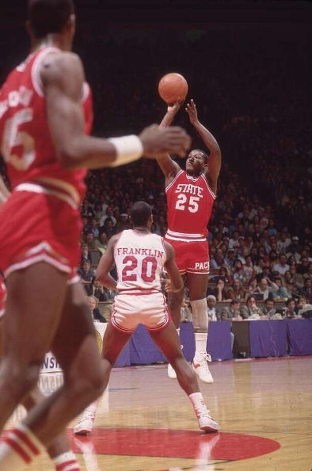 Dereck Whittenburg puts up a shot over Alvin Franklin.