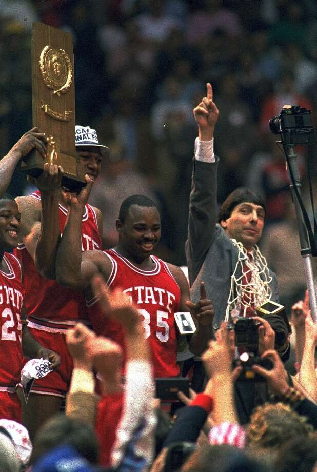 Jim Valvano, with the net around his neck, celebrates his players.