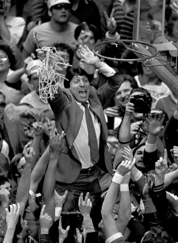 Jim Valvano holds the net aloft after the victory.