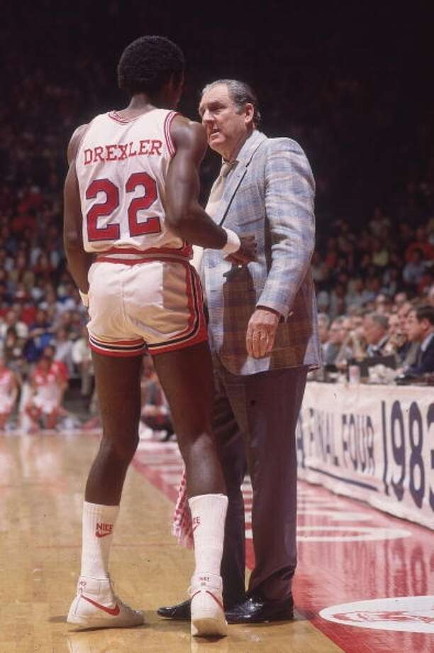UH head coach Guy Lewis talks with Clyde Drexler during the game.