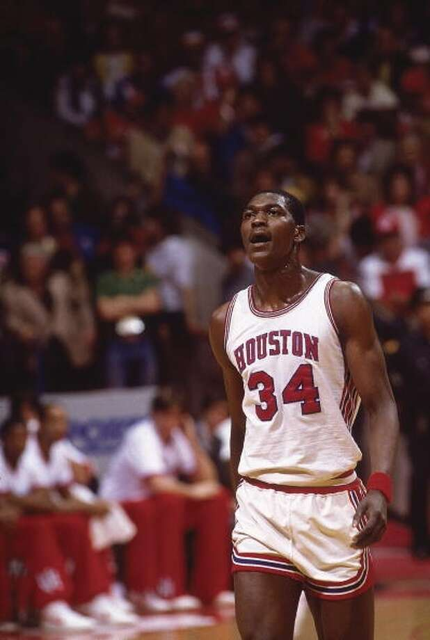 Akeem Olajuwon walks off the court after the loss.
