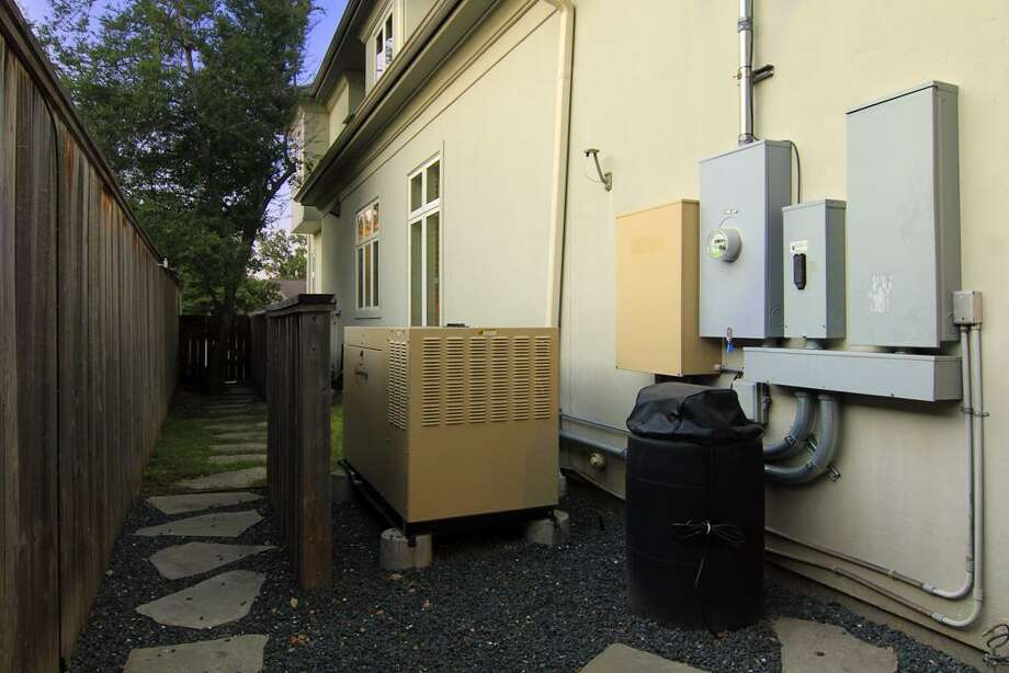 Full house generator and mosquito system. Property also has a water softner. Photo: Martha Turner Properties