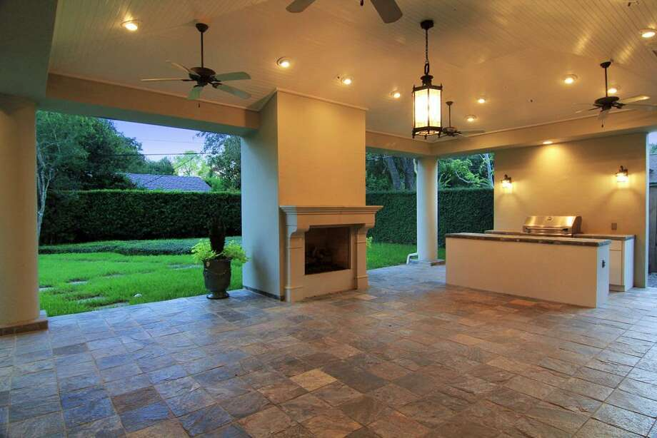 PATIO...fireplace and summer kitchen, recessed lighting, ceiling fans and plenty of space for entertaining and relaxing. Photo: Martha Turner Properties