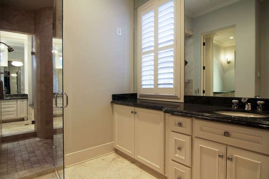 MASTER BATH...his side with private closet space, water closet and access to shower. Photo: Martha Turner Properties