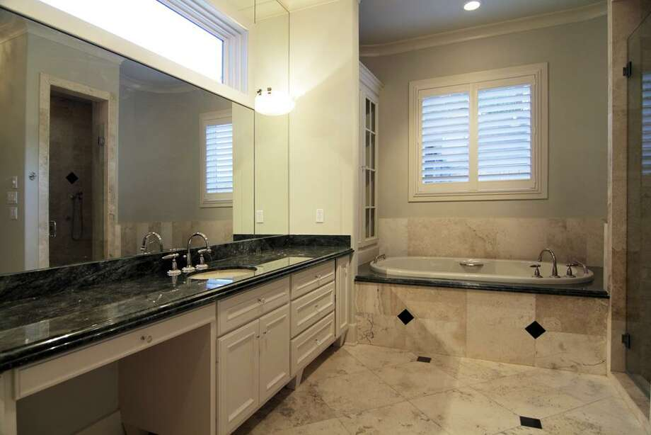 MASTER BATH...her side with whirlpool tub, separate water closet with bidet. Large closet. Double sided shower. Photo: Martha Turner Properties