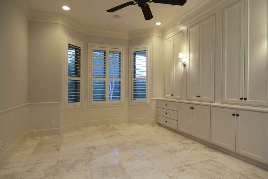 STUDY...located adjacent to master bedroom. Built-in storage and speakers. Private full bath, could be used as another bedroom if needed. Photo: Martha Turner Properties