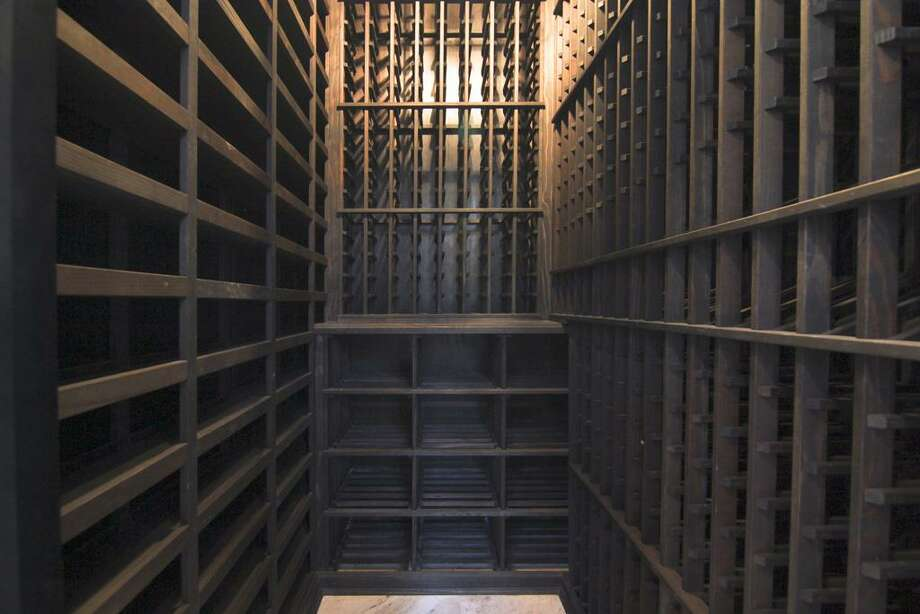 Wine Cellar...temperature controlled wine storage. Located in dining room. Photo: Martha Turner Properties