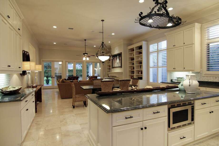 KITCHEN...view toward family room. Easy to see open layout with breakfast area. Large island and work area. Photo: Martha Turner Properties
