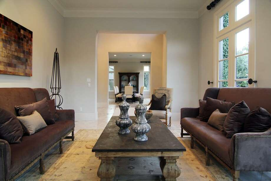 LIVING ROOM...view looking through foyer into dining room. Photo: Martha Turner Properties