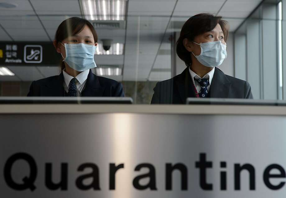 Flying into Sungshan Airport in Taipei? Don't sneeze in front of these disease-control specialists. They're on high alert due to a new strain of avian influenza that killed five people in China. Photo: Sam Yeh, AFP/Getty Images