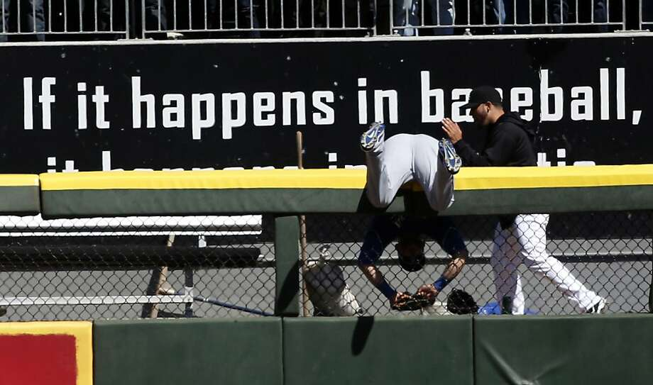 What a shame. You were so close: Kansas City's Alex Gordon was about to run down Dayan Viciedo's fly when the left-field fence at US Cellular Field in Chicago intervened. The ball fell for a home run in the White Sox bullpen, where concerned relievers offered their assistance.  Photo: Charles Rex Arbogast, Associated Press
