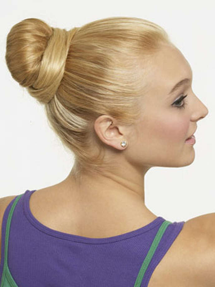 Ballerina BunHow to Get the Look:  Pull hair into a high, tight pony, then twist to create a bun. Leave out a piece of hair underneath to wrap the outside; pin it in place. Next, smooth flyaways with hairspray.