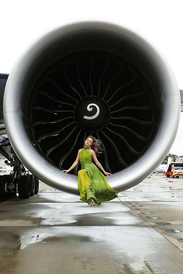 Folks, we can't begin taxiing until the ground crew gets the supermodel out of the engine turbine. Sorry for the delay: Fashion model Georgia May Jagger poses inside an engine of a British Airways Boeing 777-300ER airliner during a promotion for the new jet in Sydney. Photo: Brendon Thorne, Getty Images For British Airways