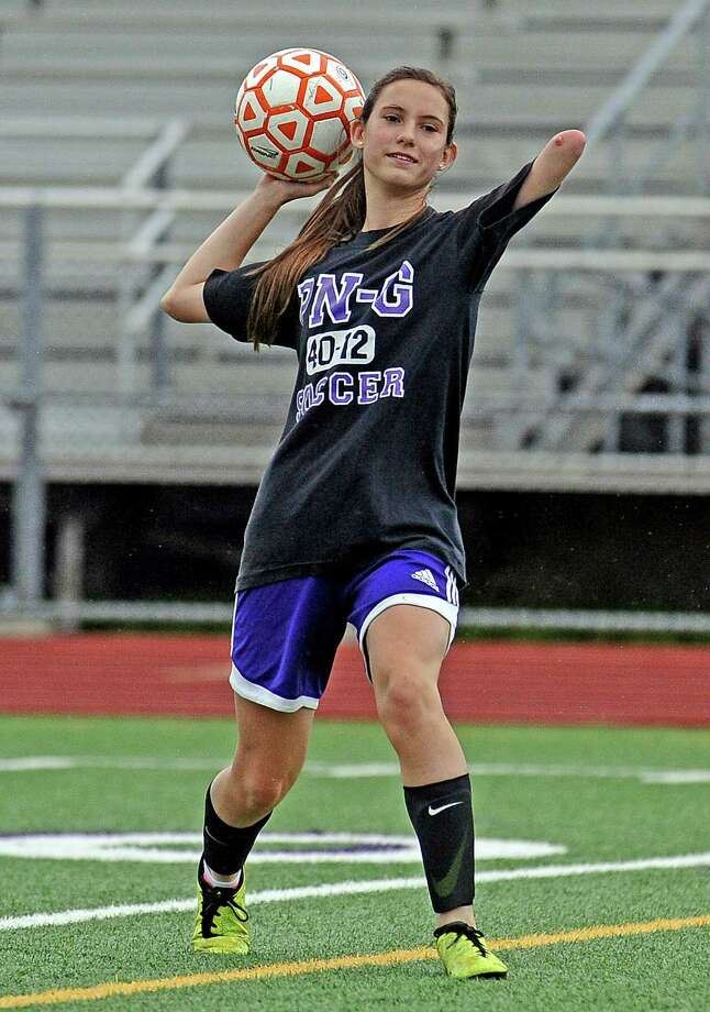 Port Neches-Groves sophomore Hannah Gerald practices throwing in the ball during practice on Tuesday, April 2, 2013. Photo taken: Randy Edwards/The Enterprise