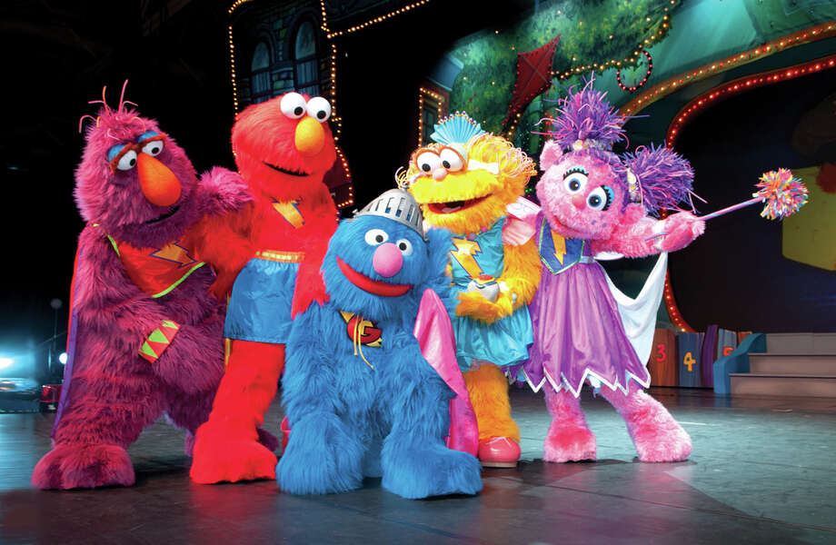 "Telly Monster, Elmo, Zoe and Abby Cadabby, who are all standing, help to get Super Grover, center, back on his feet. These characters, and about 10 others, will be featured in Sesame Street Live's presentation of ""Elmo's Super Heroes,"" at the Palace Theatre in Stamford, Conn., on Wednesday to Thursday, April 17 to April 18, 2013. For more information, visit http://www.scalive.org. Photo: Contributed Photo / Connecticut Post Contributed"