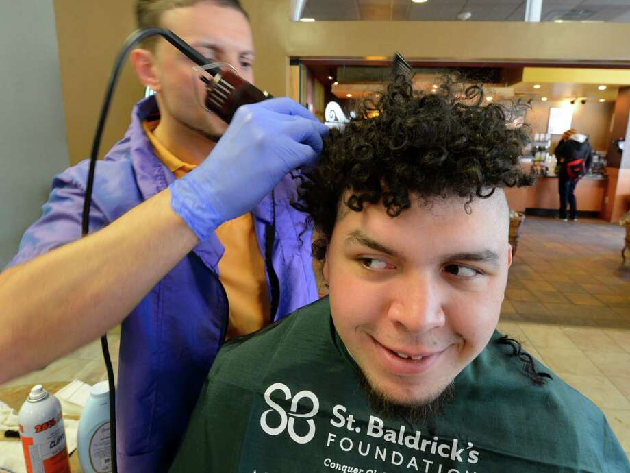 Kyle Salcedo loses his hair to benefit St. Baldrick's Foundation April 4, 2013, at The College of St. Rose in Albany, N.Y.  The St. Baldrick's Foundation is a childhood cancer charity funding the  research to help find cures for children with cancer.   (Skip Dickstein/Times Union) Photo: SKIP DICKSTEIN