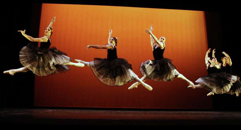 Les Ballets Trockadero de Monte Carlo, a New York-based company of all male ballet dancers, performs Thursday at Lila Cockrell Theater. The troupe emphasizes slapstick in performances. Photo: Associated Press File Photo