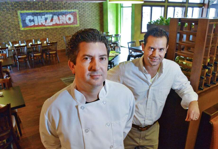 "Brothers John, left, and Bobby Mallozzi inside their new restaurant, ""Johnny's"" on State Street in Schenectady March 27, 2013. (John Carl D'Annibale / Times Union) Photo: John Carl D'Annibale / 00021648A"