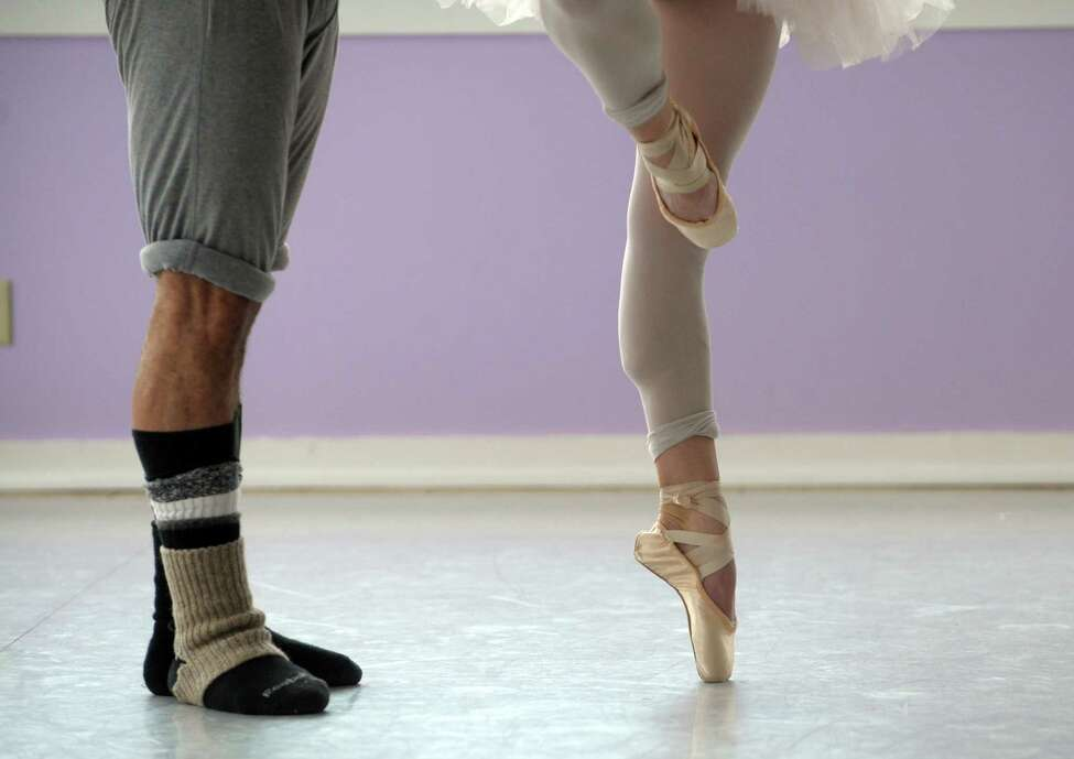 Guest dancer Vladimir Roje, left, dancer Christine Geren run through a rehearsal at the Albany Berkshire Ballet on Monday, March 25, 2013 in Albany, NY. (Paul Buckowski / Times Union)