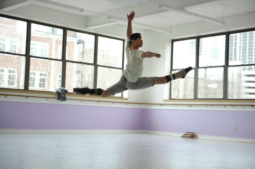 Guest dancer Vladimir Roje runs through a rehearsal at the Albany Berkshire Ballet on Monday, March 25, 2013 in Albany, NY. (Paul Buckowski / Times Union)