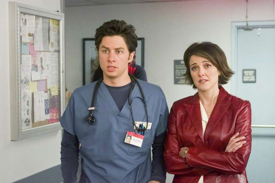 Zach Braff, aka Phillip Litt, pictured in 2002 opposite Christa Miller Lawrence. Photo: Paul Drinkwater, Getty Images / © NBC Universal, Inc.