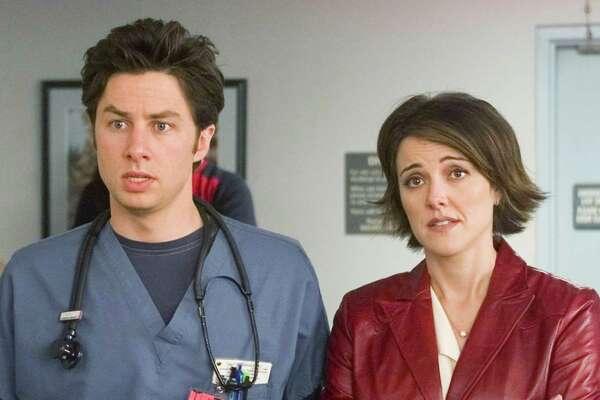 Zach Braff, aka Phillip Litt, pictured in 2002 opposite Christa Miller Lawrence.