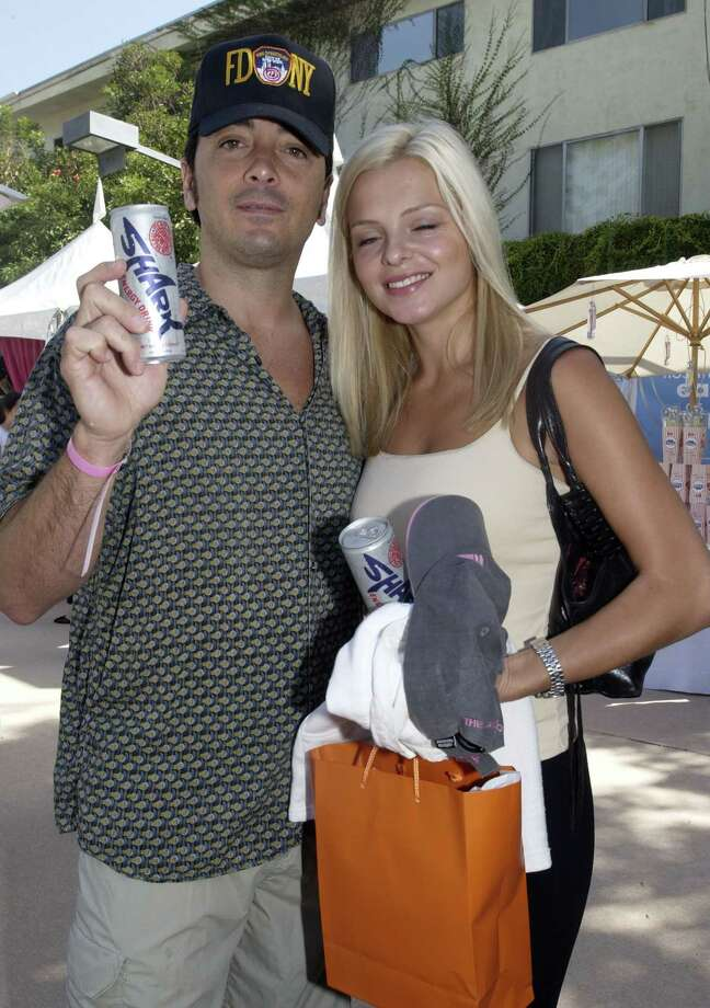 Scott Baio, aka Bob Loblaw, pictured in 2002 with a Shark Energy Drink and guest. Photo: Chris Weeks, Getty Images / WireImage