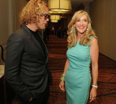 Chair Jana Arnoldy talks with Pucci designer Peter Dundas at the annual Houston Chronicle\'s Best Dressed Luncheon at the Westin Galleria Hotel Tuesday April 3, 2013.(Dave Rossman photo) Photo: Dave Rossman, For The Houston Chronicle / © 2013 Dave Rossman
