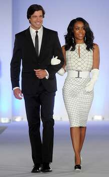 Honoree Tiffany Smith is escorted down the runway at the annual Houston Chronicle\'s Best Dressed Luncheon at the Westin Galleria Hotel Tuesday April 3, 2013.(Dave Rossman photo) Photo: Dave Rossman, For The Houston Chronicle / © 2013 Dave Rossman