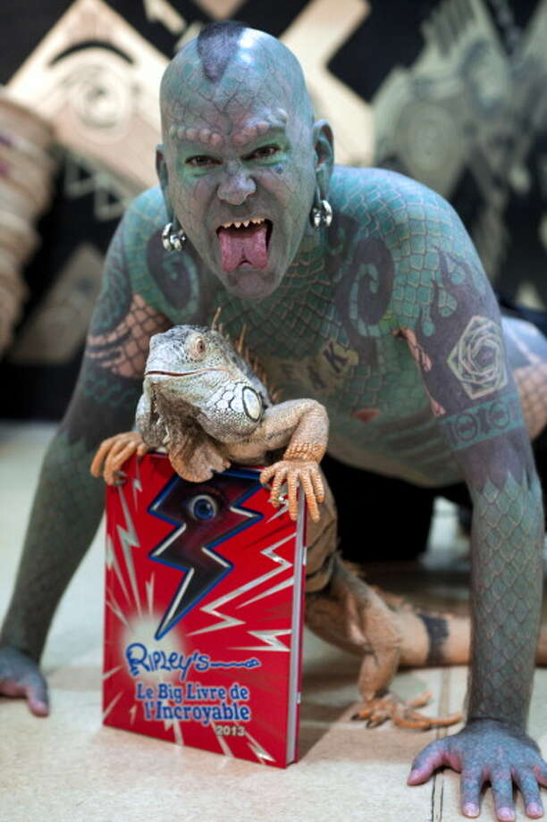"Well ... 4 percent of American voters say they believe ""lizard people"" control our societies by gaining political power. Photo: MARTIN BUREAU, Getty / 2012 AFP"