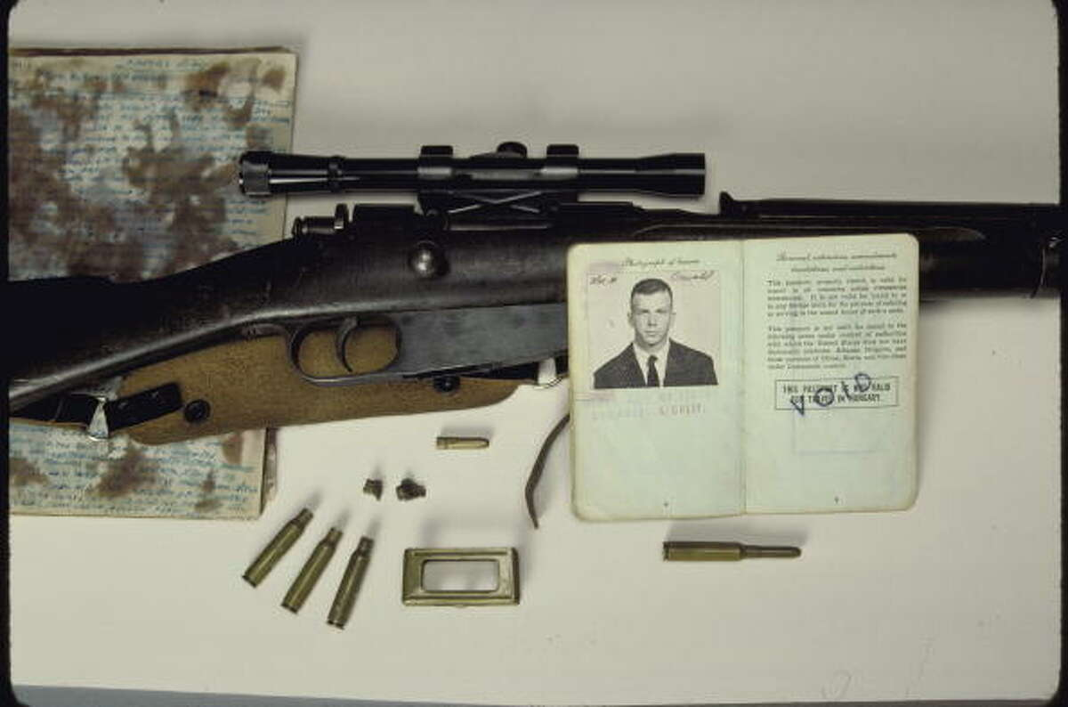 A passport, rifle, bullets and other items belonging to assassin Lee Harvey Oswald being displayed by the National Archives.