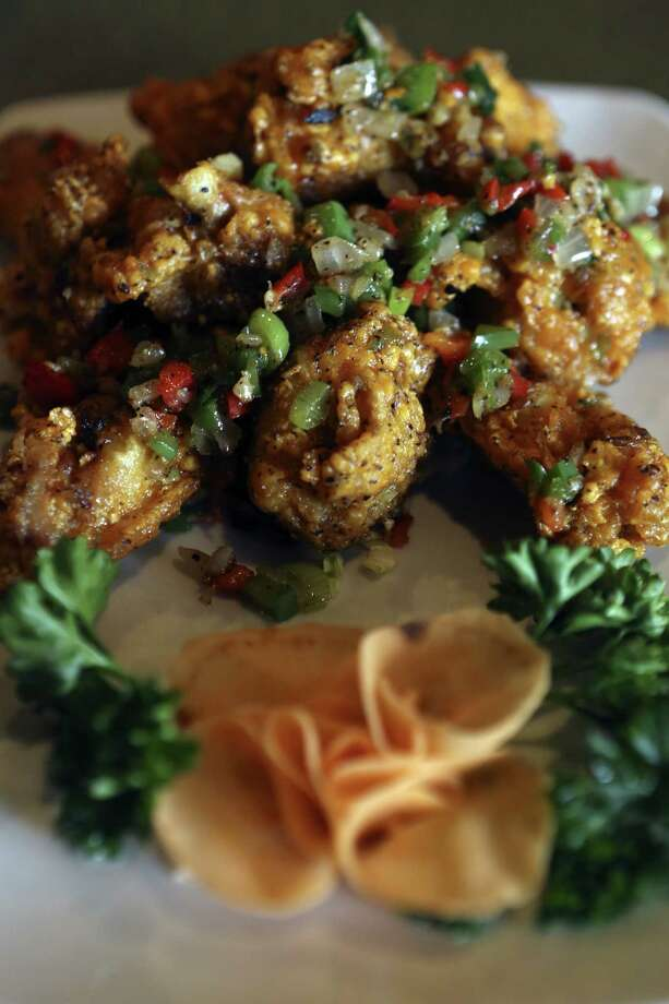 The salt and pepper wings offer a different take on an otherwise familiar dish. Photo: Helen L. Montoya Photos / San Antonio Express-News