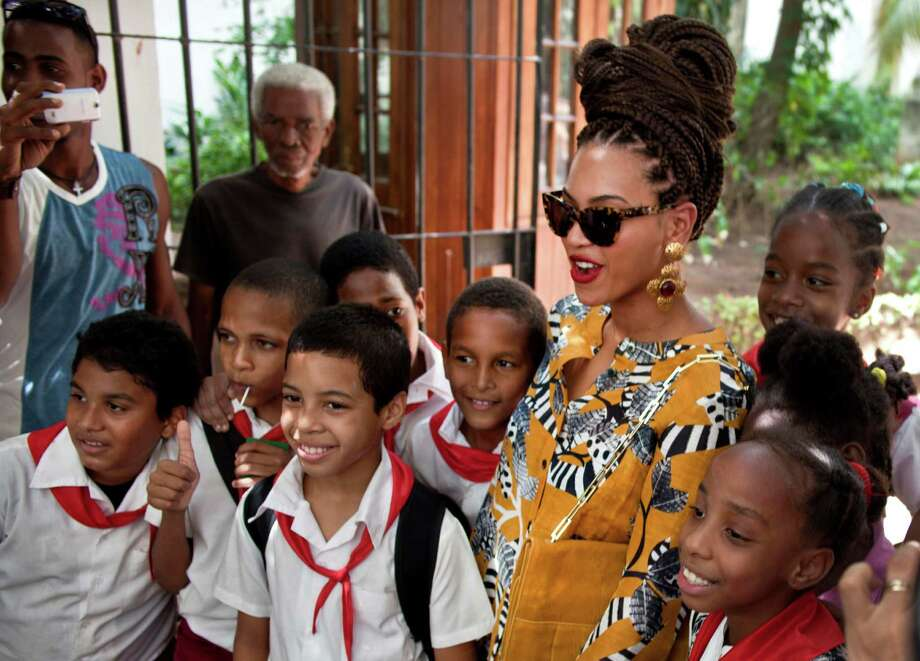 U.S. singer Beyonce poses for photos with school children as she tours Old Havana, Cuba, Thursday, April 4, 2013. Beyonce is in Havana with her husband, rapper Jay-Z, on their fifth wedding anniversary. (AP Photo/Ramon Espinosa) Photo: Ramon Espinosa