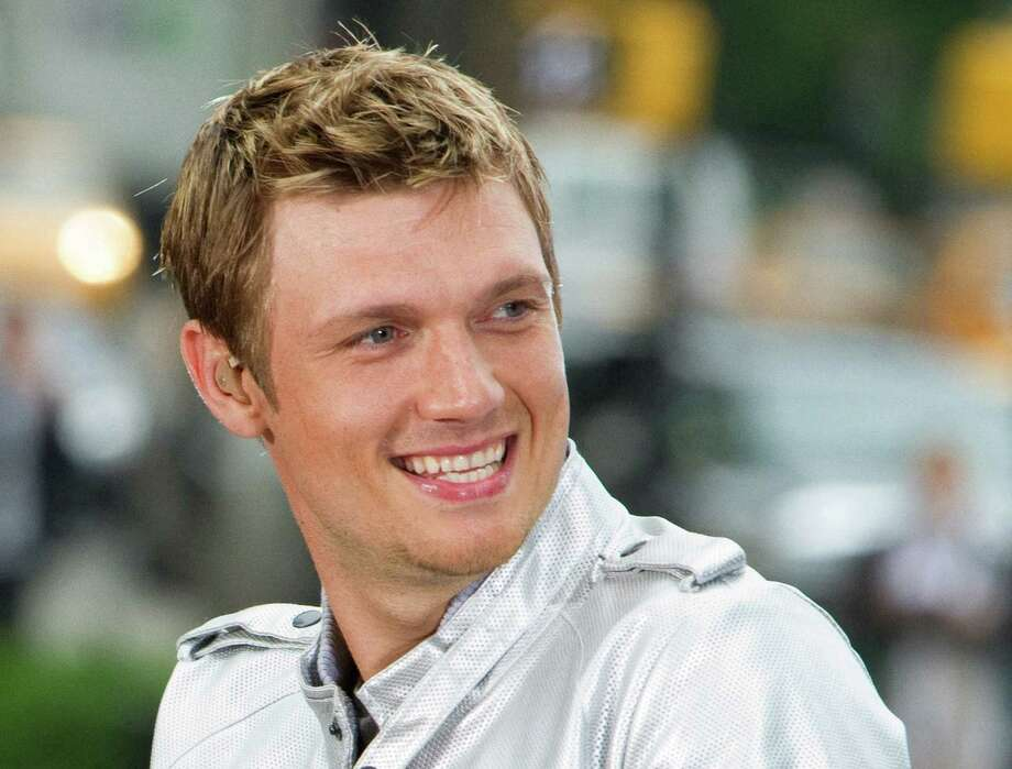 "FILE - This May 24, 2010 file photo shows Nick Carter of the Backstreet Boys performing on CBS News' ""The Early Show"" in New York. The Backstreet Boys singer proposed to his fitness trainer girlfriend Lauren Kitt in February, and he says they may bring their marriage to the small screen. ""There have been offers and opportunities to film the actually wedding, like a TV show,"" the 33-year-old said in a recent interview. The couple appears together in a series of fitness webisodes called ""Kit Fitt."" (AP Photo/Charles Sykes, file) Photo: Charles Sykes"