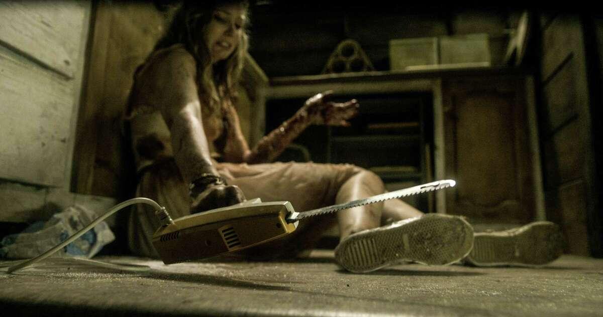 Elizabeth Blackmore in TriStar Pictures' horror EVIL DEAD.
