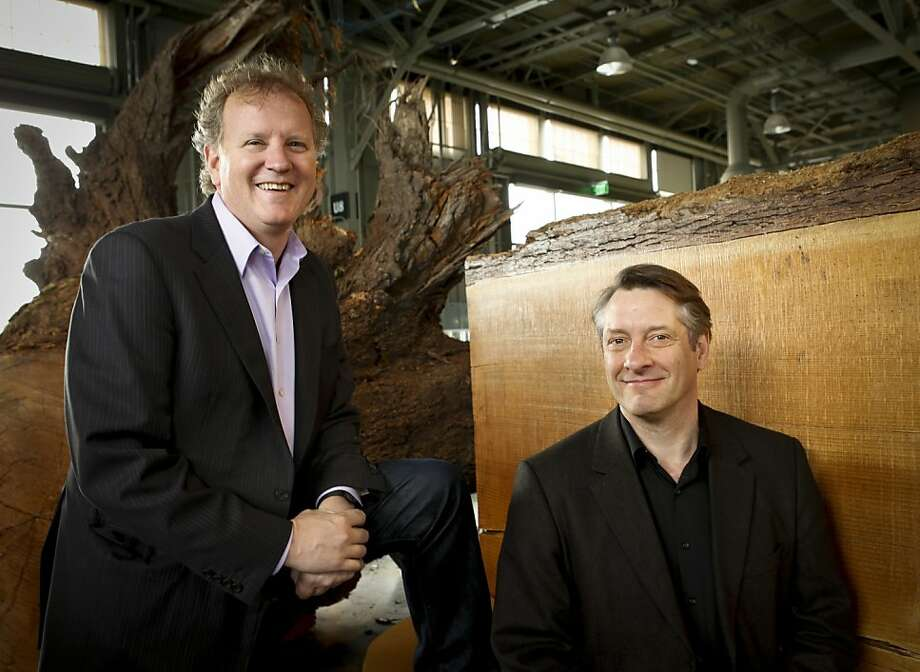 Dennis Bartels (left), executive director of the Exploratorium, and Tom Rockwell, director of exhibits, say they love their jobs and feel fortunate to work in such a magical place. Photo: Russell Yip, The Chronicle