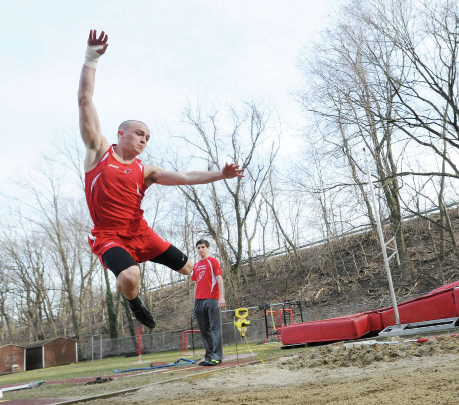 Greenwich High School's Chandler LaSorsa, a junior, competes in the long jump during the boys high school track meet between Greenwich High School and Bridgeport Central High School at Greenwich, Thursday, April 4, 2013. Photo: Bob Luckey / Greenwich Time