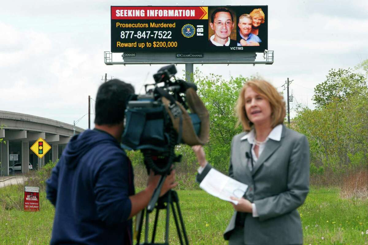 Pat Villafranca a special agent with the FBI Houston office gives a statement to the media about their new billboard advertisement that shows the $200,000 reward for information leading to arrests in those involved in killing the Mike McLelland the Kauffman County District Attorney and his wife on the on State Highway 6 near FM 521Thursday, April 4, 2013, in Arcola. The state-wide billboard campaign will also be displayed on digital billboards at Hwy 225 at Red Bluff, East Belt at Pasadena Blvd., and the Gulf Fwy at Calder. Those with information about the crime can call 877-847-7522. ( Johnny Hanson / Houston Chronicle )