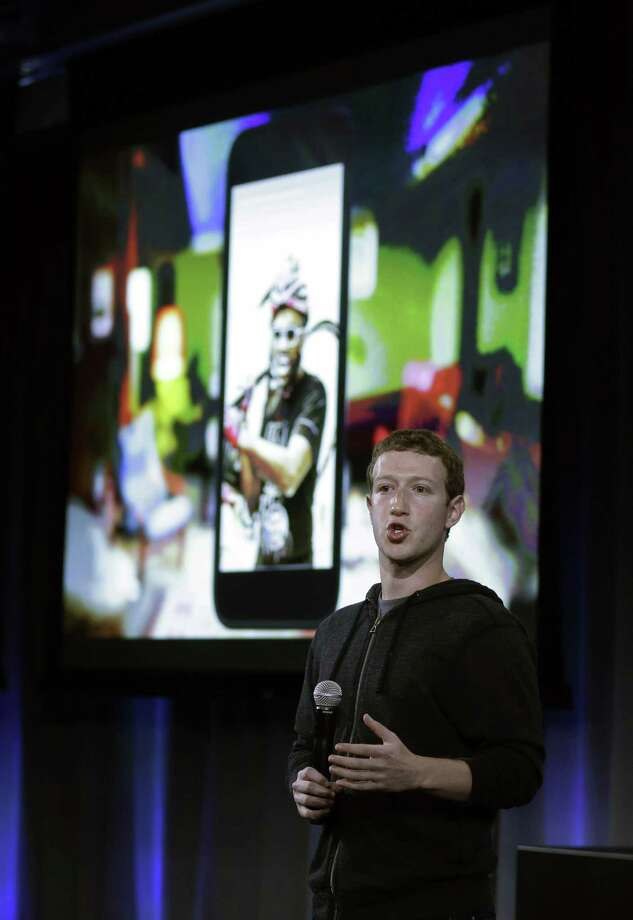 Facebook CEO Mark Zuckerberg speaks at the company's headquarters in Menlo Park, Calif., Thursday, April 4, 2013. Zuckerberg says the company is not building a phone or an operating system. Rather, Facebook is introducing  a new experience for Android phones. The idea behind the new Home service is to bring content right to you, rather than require people to check apps on the device.   (AP Photo/Marcio Jose Sanchez) Photo: Marcio Jose Sanchez