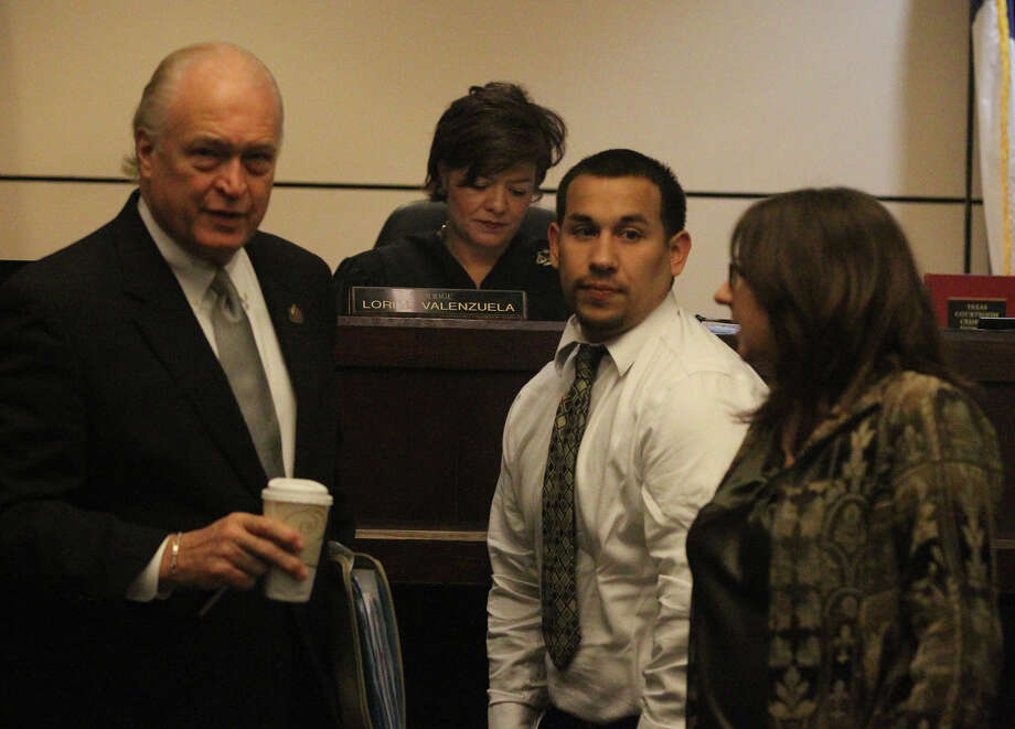Defandant Mark Anthony Garcia,24, (center) appears Thursday April 4, 2013 before Judge Lori Valenzuela with attorneys Ed Bartolomei (left) and Linda Corley (right) at the Cadena-Reeves Justice Center. Garcia is on trial for a murder that took place in December 2008. Photo: JOHN DAVENPORT, SAN ANTONIO EXPRESS-NEWS / ©San Antonio Express-News