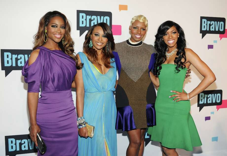 """The Real Housewives of Atlanta\"" cast members, from left, Kenya Moore, Cynthia Bailey, NeNe Leakes and Porsha Stewart attend the Bravo Network 2013 Upfront on Wednesday April 3, 2013 in New York. (Photo by Evan Agostini/Invision/AP) Photo: Evan Agostini, Associated Press / Invision"