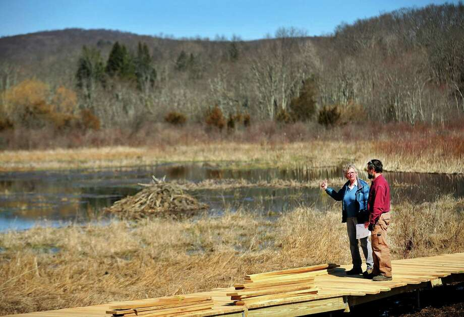 Marge Josephson, president of the Naromi Land Trust, and contractor Peter Jensen, discuss the boardwalk they're building on the Wimisink Swamp Reserve in Sherman, Conn. Thursday, April 4, 2013. Photo: Michael Duffy / The News-Times