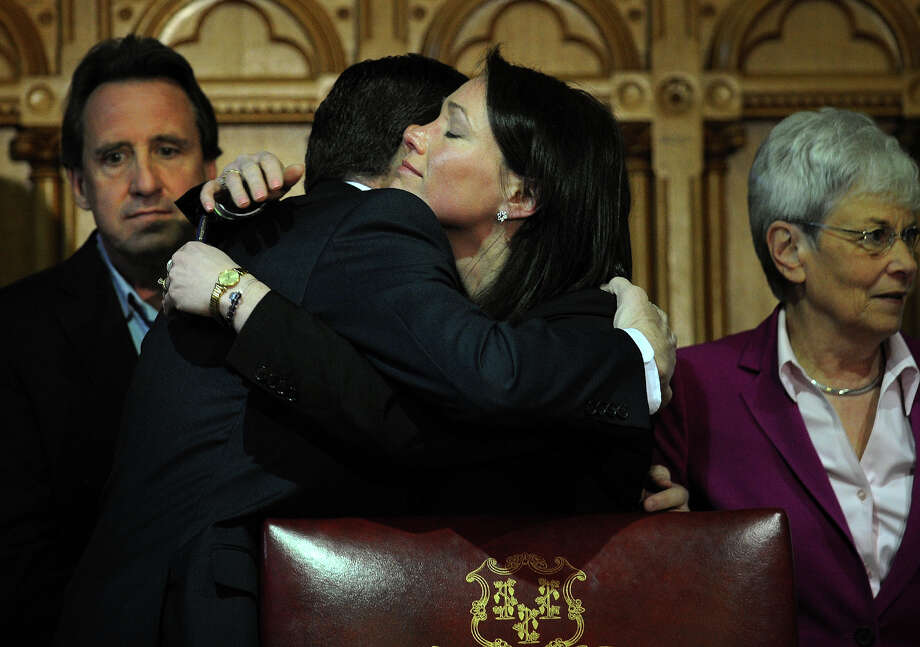 Governor Dannel P. Malloy hugs Nicole Hockley, mother of slain Sandy Hook Elementary student Dylan Hockley, after signing the Gun Violence Prevention and Children's Safety act law at the Capitol in Hartford, Conn. on Thursday, April 4, 2013. Photo: Brian A. Pounds / Connecticut Post