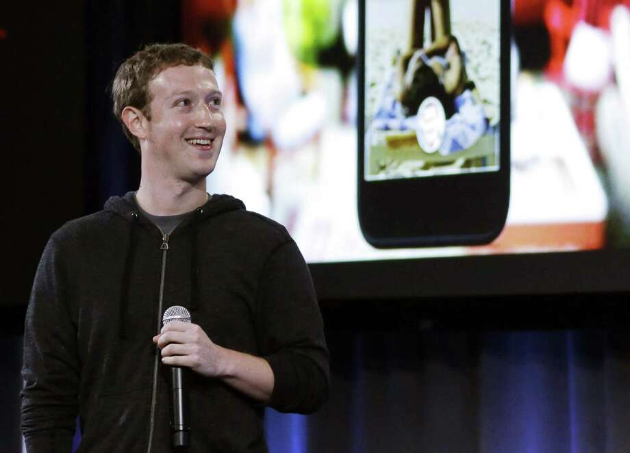 Facebook CEO Mark Zuckerberg says the company is not building a phone or an operating system. Rather, Facebook is introducing  a new experience for Android phones. Photo: Marcio Jose Sanchez, STF / AP