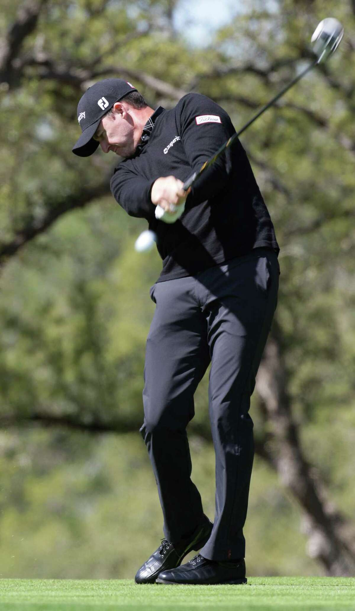 Jimmy Walker of Boerne, tees off on the 6th during the first round of the Valero Texas Open Thursday April 4, 2013. He shot a 71 on the first round.