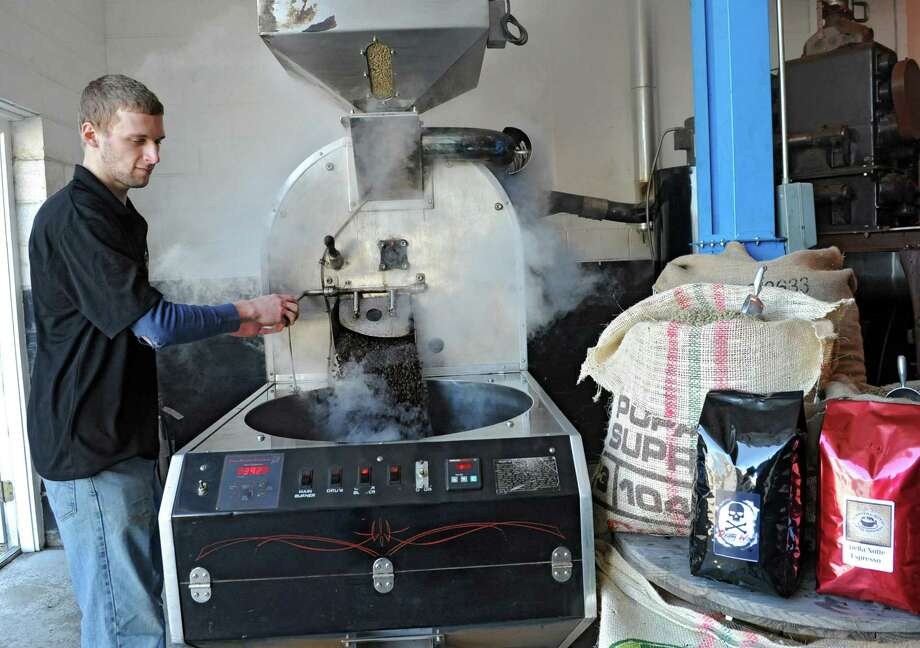 Master Roaster Chris Pacileo roast a batch of Death Wish coffee at the Capital City  Coffee Roasters plant on Thursday, April 4, 2013 in Castleton, N.Y. (Lori Van Buren / Times Union) Photo: Lori Van Buren