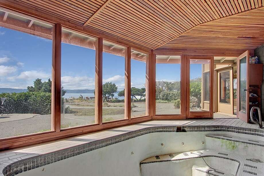 Hot tub of 11065 Arroyo Beach Place S.W., in Arbor Heights. The 2,950-square-foot home, built in 1977, has four bedrooms, 2.5 bathrooms, wood walls, vaulted wood ceilings, two stone fireplaces, walls of windows overlooking Puget Sound, a rec room, decks, patios and a boat ramp on half an acre with 72 feet of waterfront. It's listed for $1.5 million. Want to see it? There's an open house scheduled from noon to 4 p.m. on Sunday. Photo: Courtesy David Katt/Prudential Northwest Realty Associates