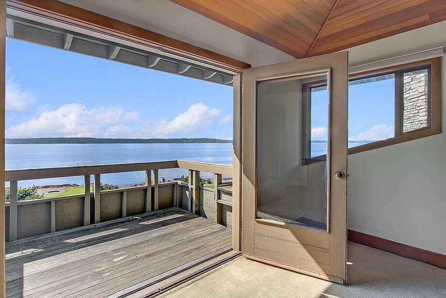 Master bedroom deck of 11065 Arroyo Beach Place S.W., in Arbor Heights. The 2,950-square-foot home, built in 1977, has four bedrooms, 2.5 bathrooms, wood walls, vaulted wood ceilings, two stone fireplaces, walls of windows overlooking Puget Sound, a rec room, decks, patios and a boat ramp on half an acre with 72 feet of waterfront. It's listed for $1.5 million. Want to see it? There's an open house scheduled from noon to 4 p.m. on Sunday. Photo: Courtesy David Katt/Prudential Northwest Realty Associates